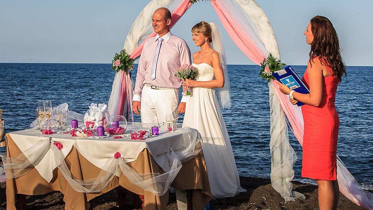 Wedding by the sea on the island of santorini symbolic wedding ceremony by the sea in greece on santorini buycottarizona