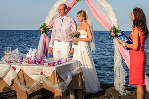 Symbolic  ceremony, A wedding by the sea on the island of Santorini