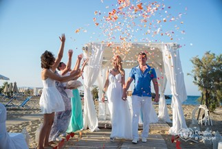 Elena's and Peter's beach ceremony in a white gazebo